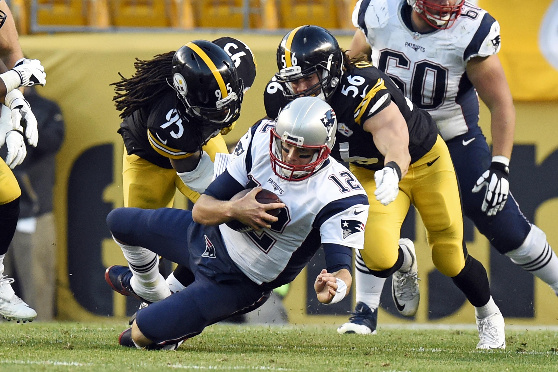 Brady_under_pressure_football_04008