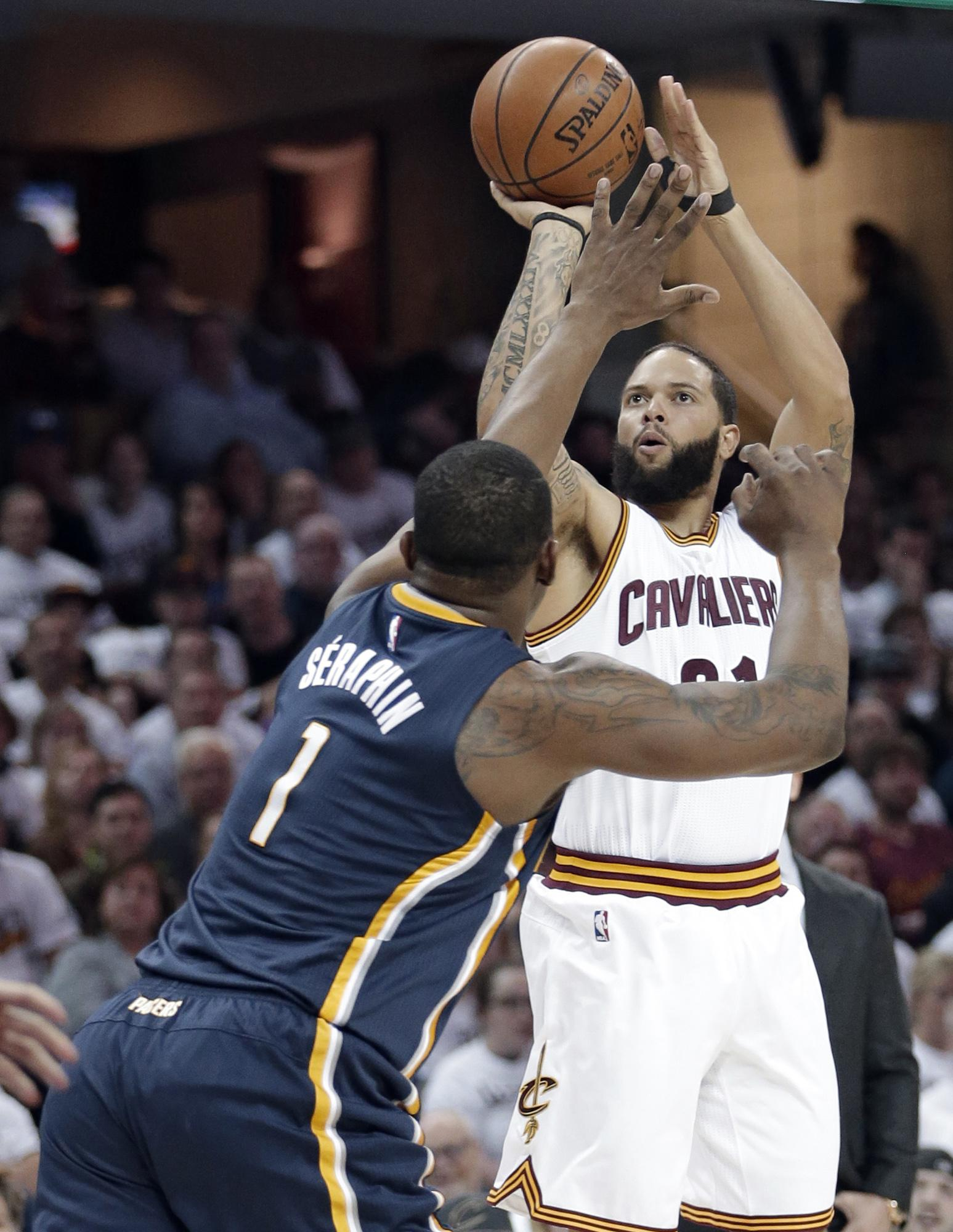 Cavaliers_williams_busts_out_basketball_89383